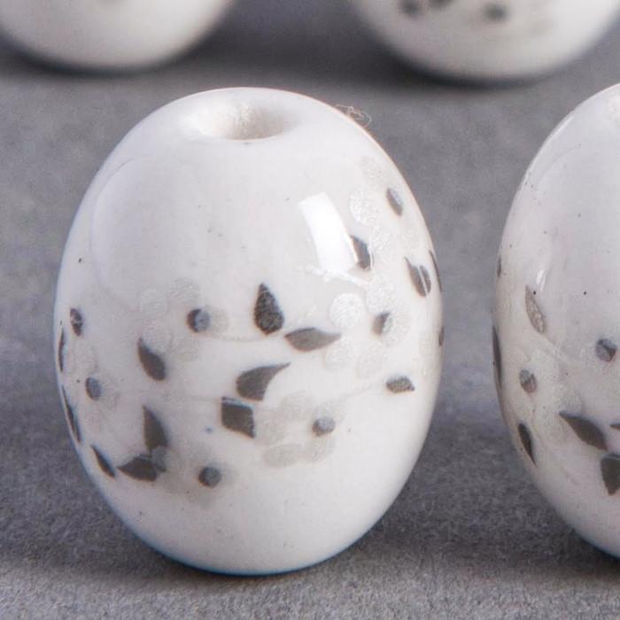 Perle en céramique Fleurie ovale blanche 14mm x1