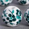 Perle en céramique Fleurie ronde Vert / Bleu foncé 20mm x1