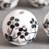 Perle en céramique Fleurie ronde Noire 12mm x1