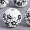 Perle en céramique Fleurie ronde Noire 10mm x1