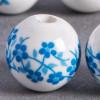 Perle en céramique Fleurie ronde Bleu turquoise 20mm x1