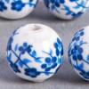 Perle en céramique Fleurie ronde Bleu roi x1