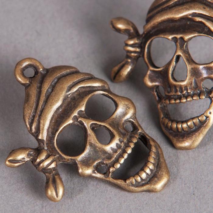 Breloque tête de mort pirate 27mm bronze x1