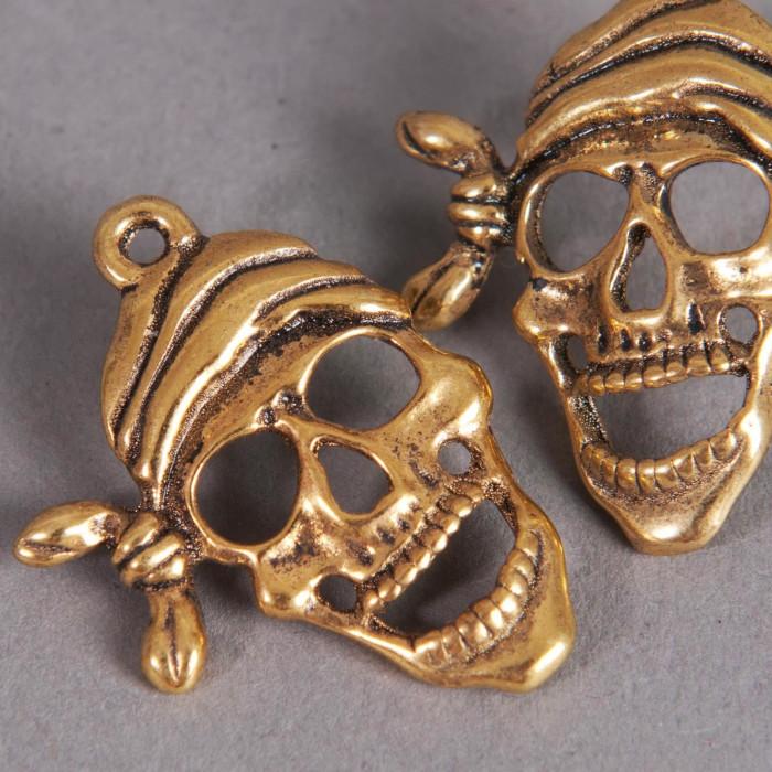 Breloque tête de mort pirate 27mm dorée x1