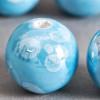 Perle en céramique à motifs ronde bleu turquoise 20mm x1