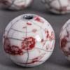 Perle en céramique marbrée blanc / rouge 24mm x1