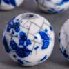 Perle en céramique marbrée blanc / bleu roi 24mm x1