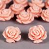 Fleur en poudre de nacre 18 mm rose clair x1