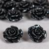 Fleur en poudre de nacre 18 mm noire x1